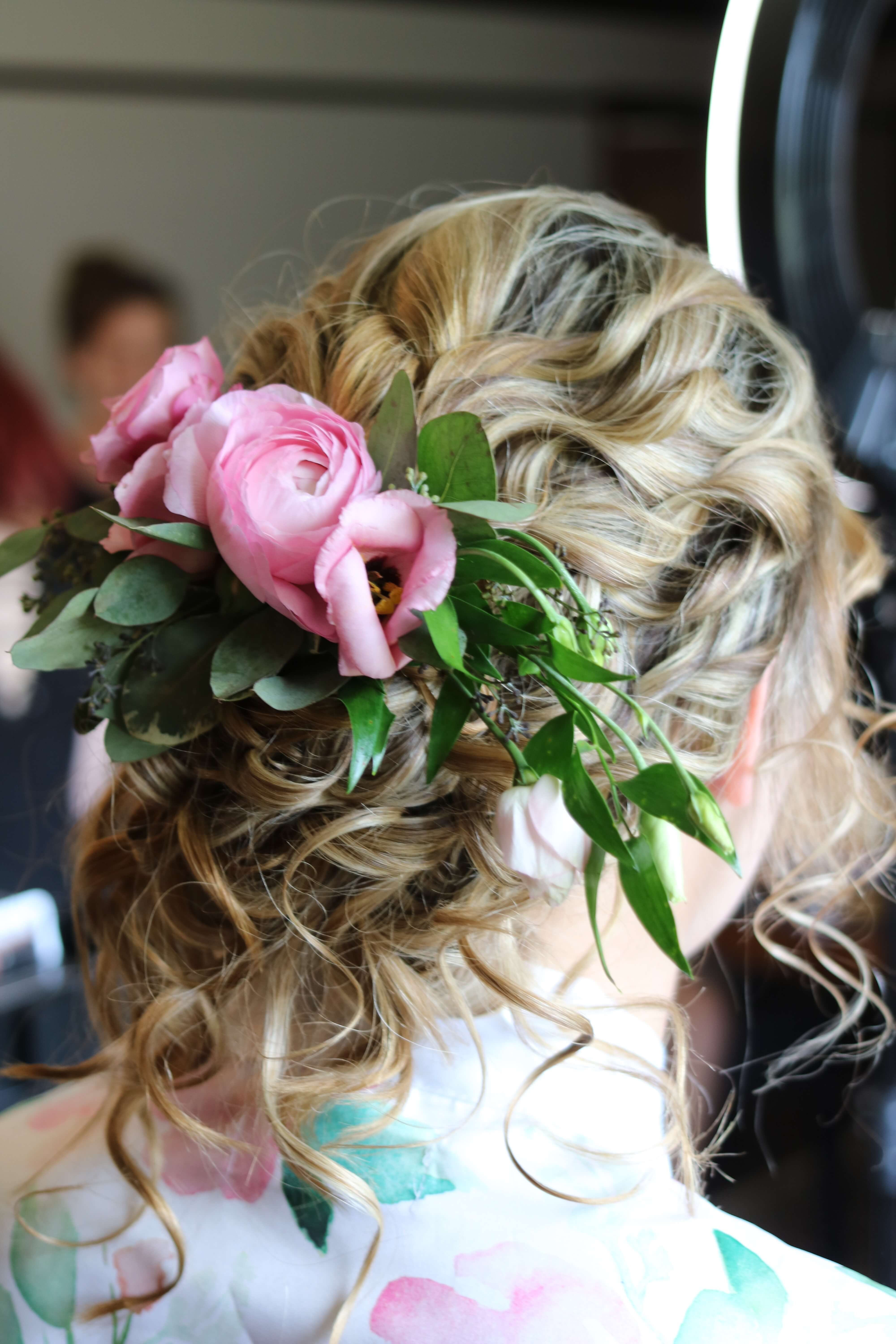 Loose wedding updo with flowers